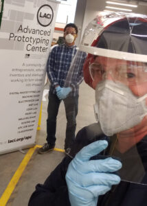 APC employees Lauritz David Jr. (left) and Nick Albert (right) inside the shop where they have produced over 30,000 face shields so far.